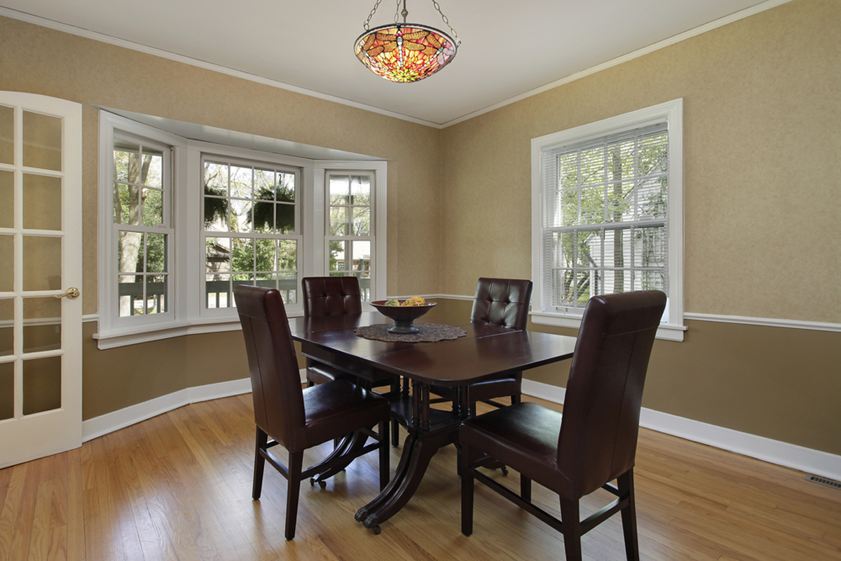 """Hanging one fixture too high in the center of the room makes it feel """"lost""""."""