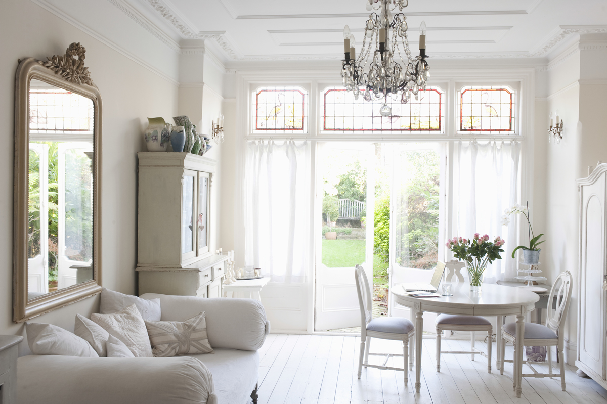 A small room benefits from light colors and adequate lighting to create a feel of spaciousness.