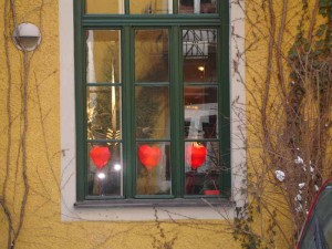 """""""One From The Heart"""" lamp by Ingo Maurer. Photographed in the window of their Munich showroom"""
