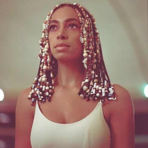 solange-knowles-braids-african-beads-cowry-shells-hairstyle.png