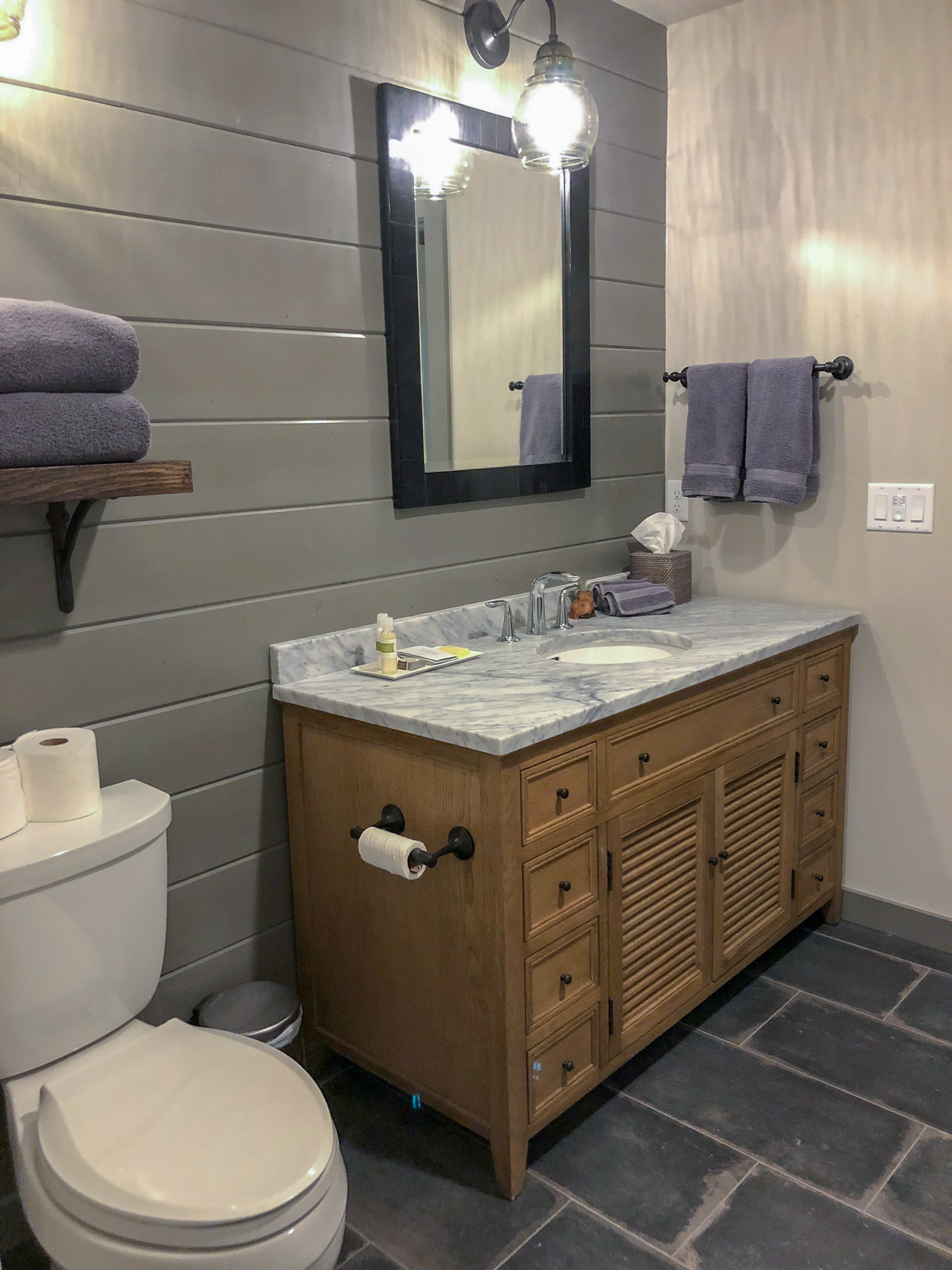 The bathroom comes with a full vanity and handmade lavender bath products