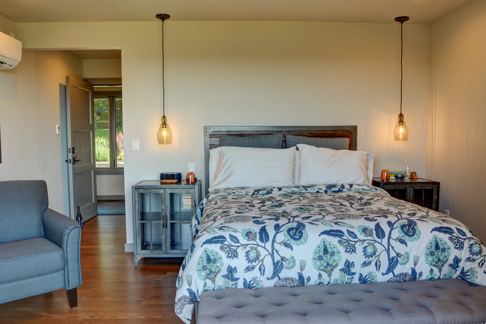The Yamhill-Carlton room has a full queen bed and a sitting area, to enjoy morning coffee with a view
