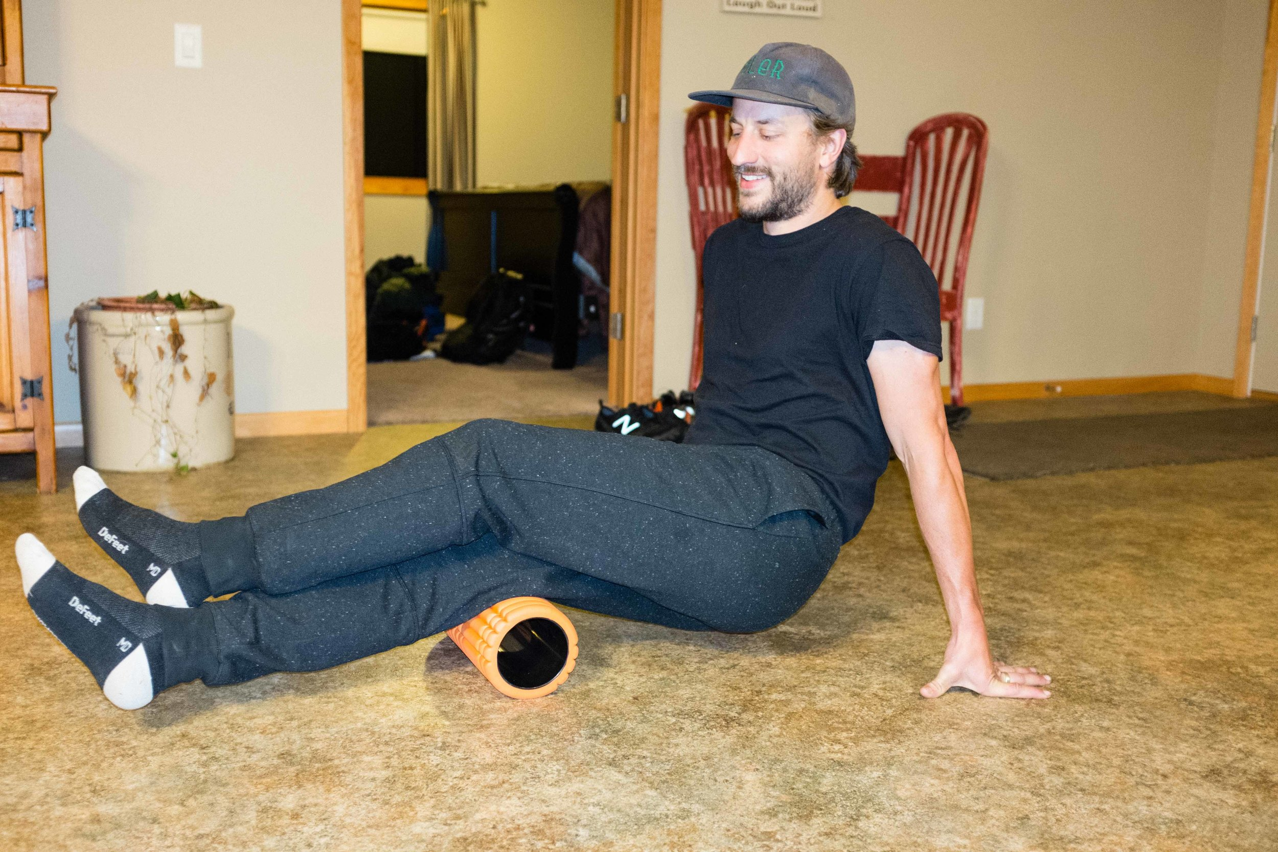 Here's Dan rolling out those muscles the night before the race. All of us would take a few moments to painfully loosen up those hip flexors. Because, stretching before strenuous activity is important. Pro tip.