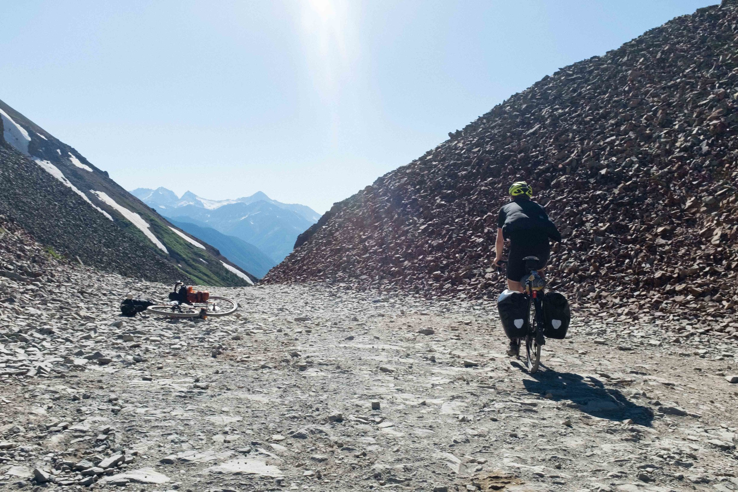 Ben summiting Ophir Pass. The top .5 mile or so and 750 feet of elevation gain of the climb was ridable, so we got back on, bombed through a boulder field, and then began descending on some legitamately sketchy shale.