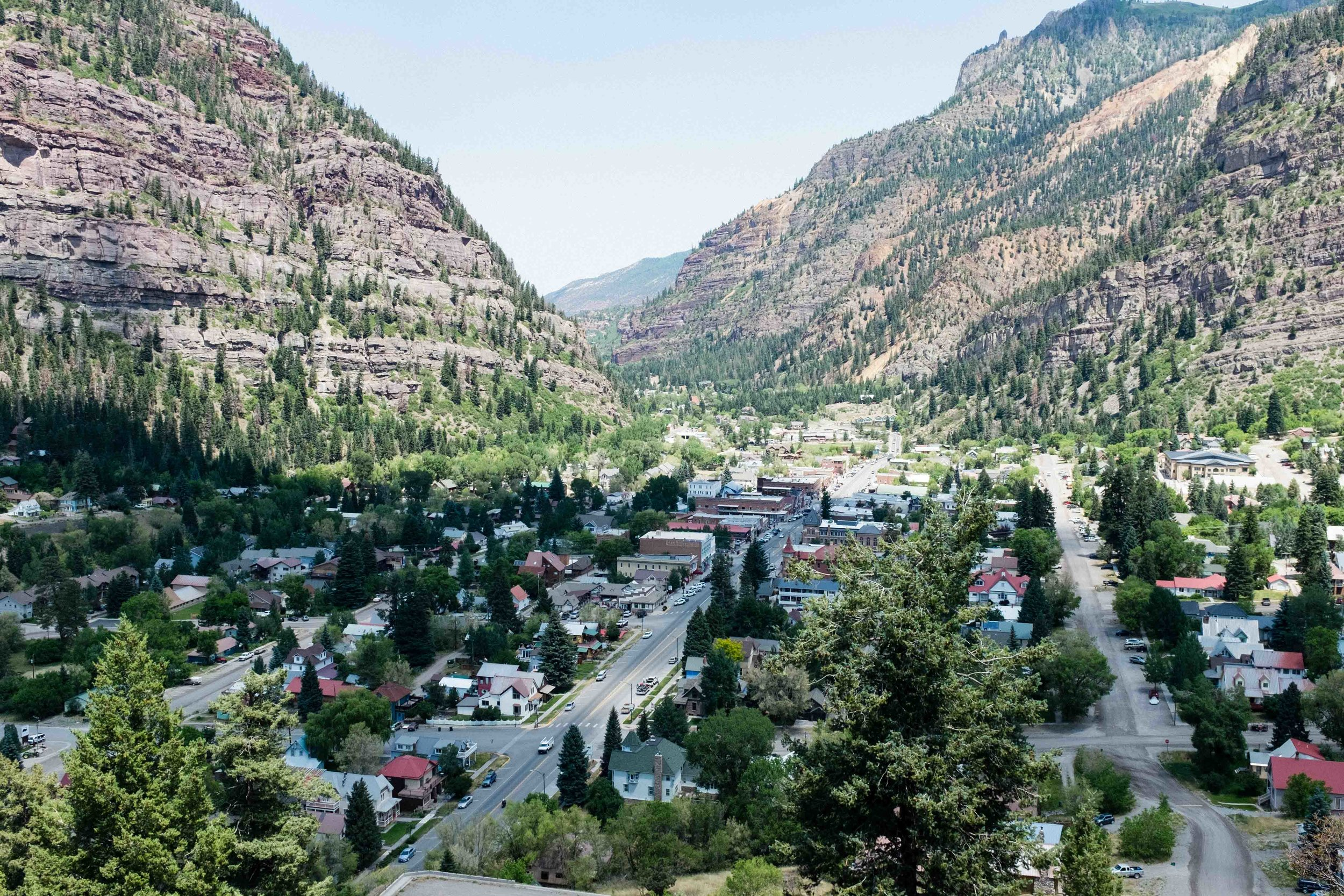 Ouray: Gateway to the Million Dollar Highway. Here we began climbing up Red Mountain Pass, 13 miles, 4,500' of elevation gain and a summit over 11,000 ft. There was an equal sense of awe over the beauty surrounding us, and the daunting physical task that lay ahead.