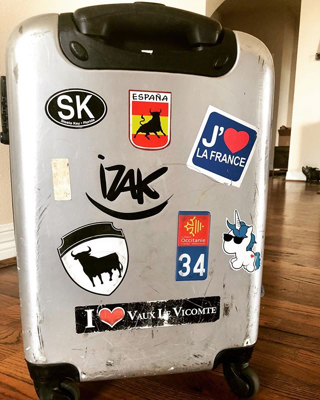 My poor carry-on is so beat but I don't want to give up my stickers! #luggage #travel #stickers #adventure