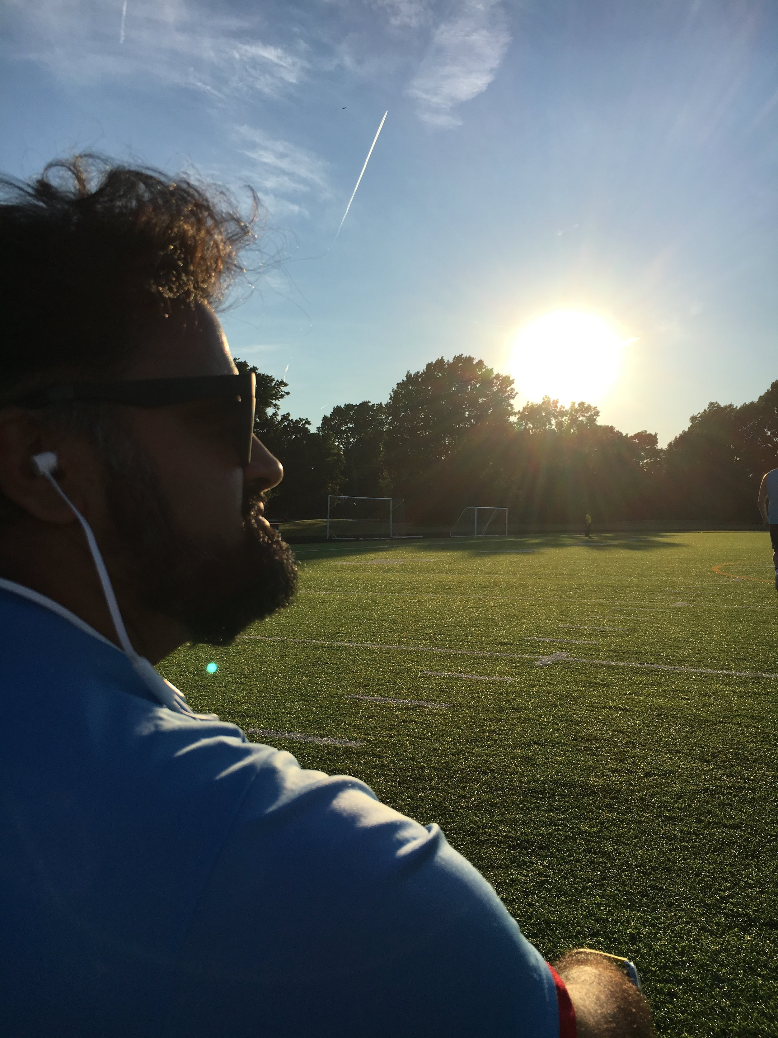 Mapleton FC Manager Jai Desai enjoys Wagner's Tannhäuser Overture whilst viewing his team's play.