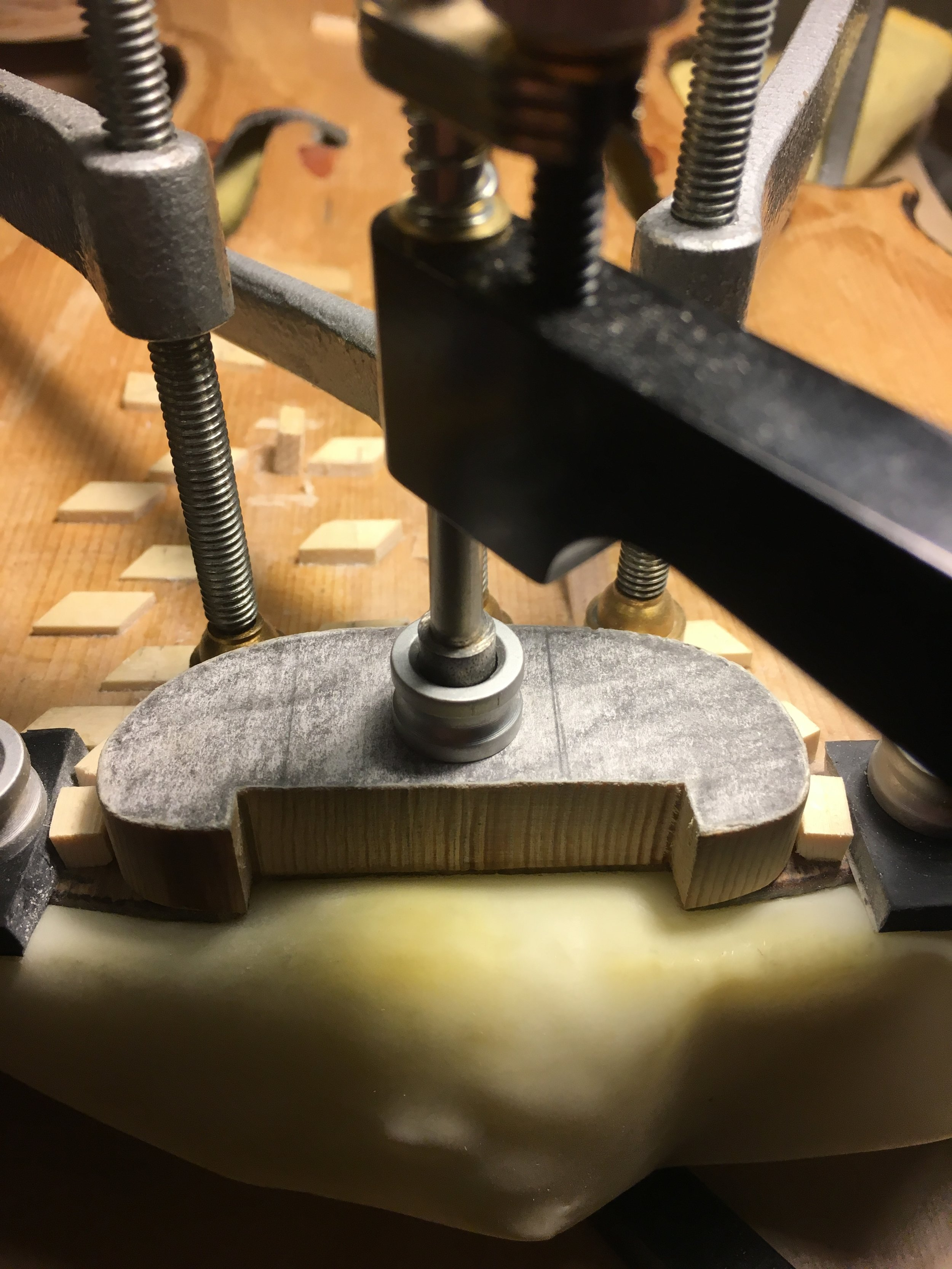 """With the top properly secured in a cast, and temporary cleats precisely aligned to guide the new patch into the bed, this patch is now ready to begin the careful process of """"chalk fitting"""" to achieve a perfect fit."""
