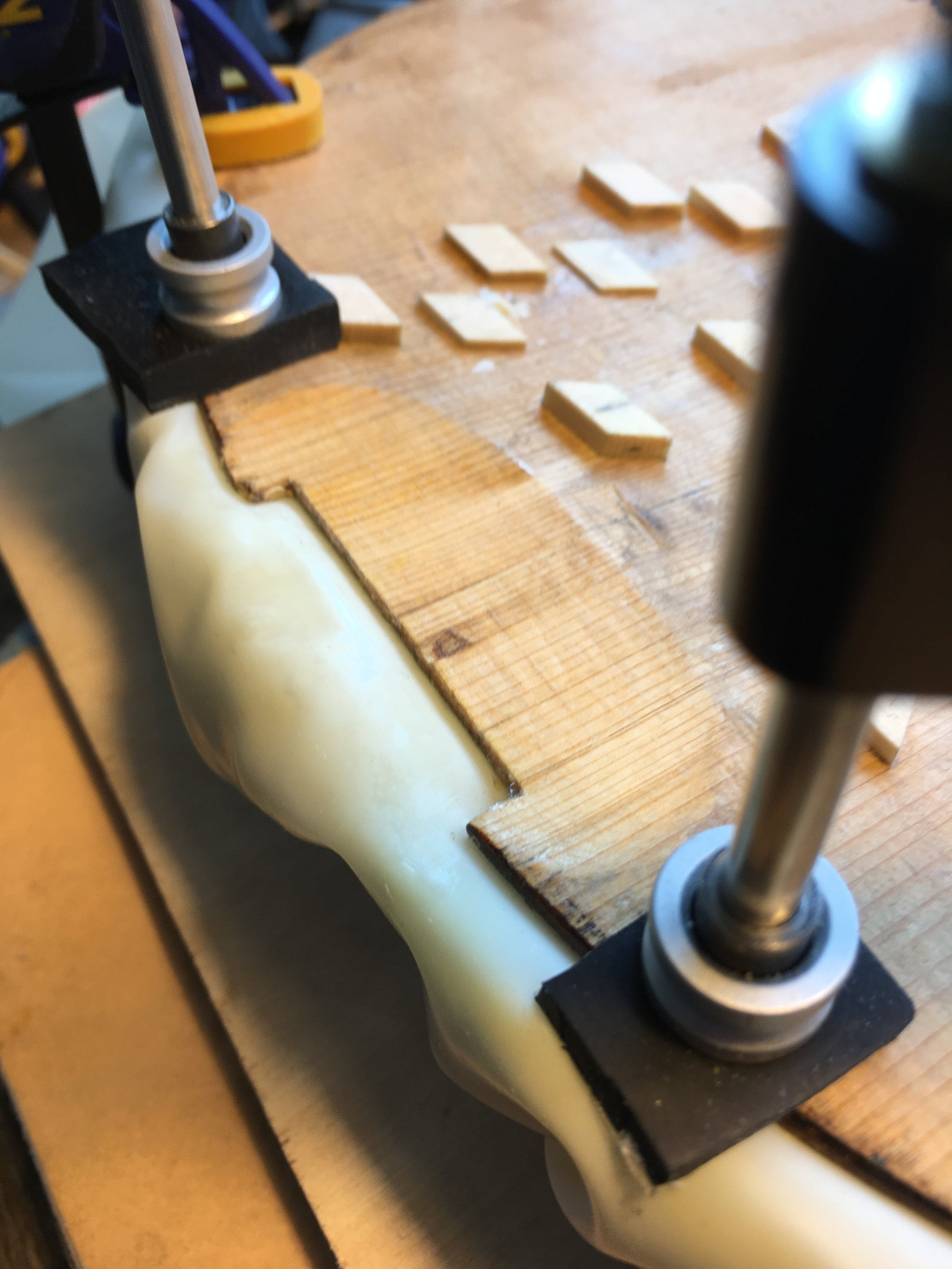 Patch beds are conservatively and precisely carved while the instrument's top is supported in a cast before fitting an inlaid patch .