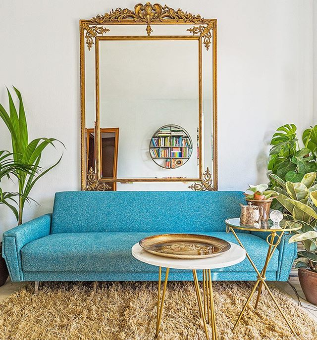 The stunning living room of @marcperidis perfectly illustrating the magic of one of the worlds best colour combinations -  Turquoise and Gold 💛🌿💧#scaredspaces • • • • • #interiordesign #interiordesigner #interiors #interiorstyle #interiorstyling #interiordetails #homedecor #decoration #marcperidis #blueandgold #turquoiseandgold #livingroominspo #livingroom #bluesofa #goldfurniture #gold #colourinspo