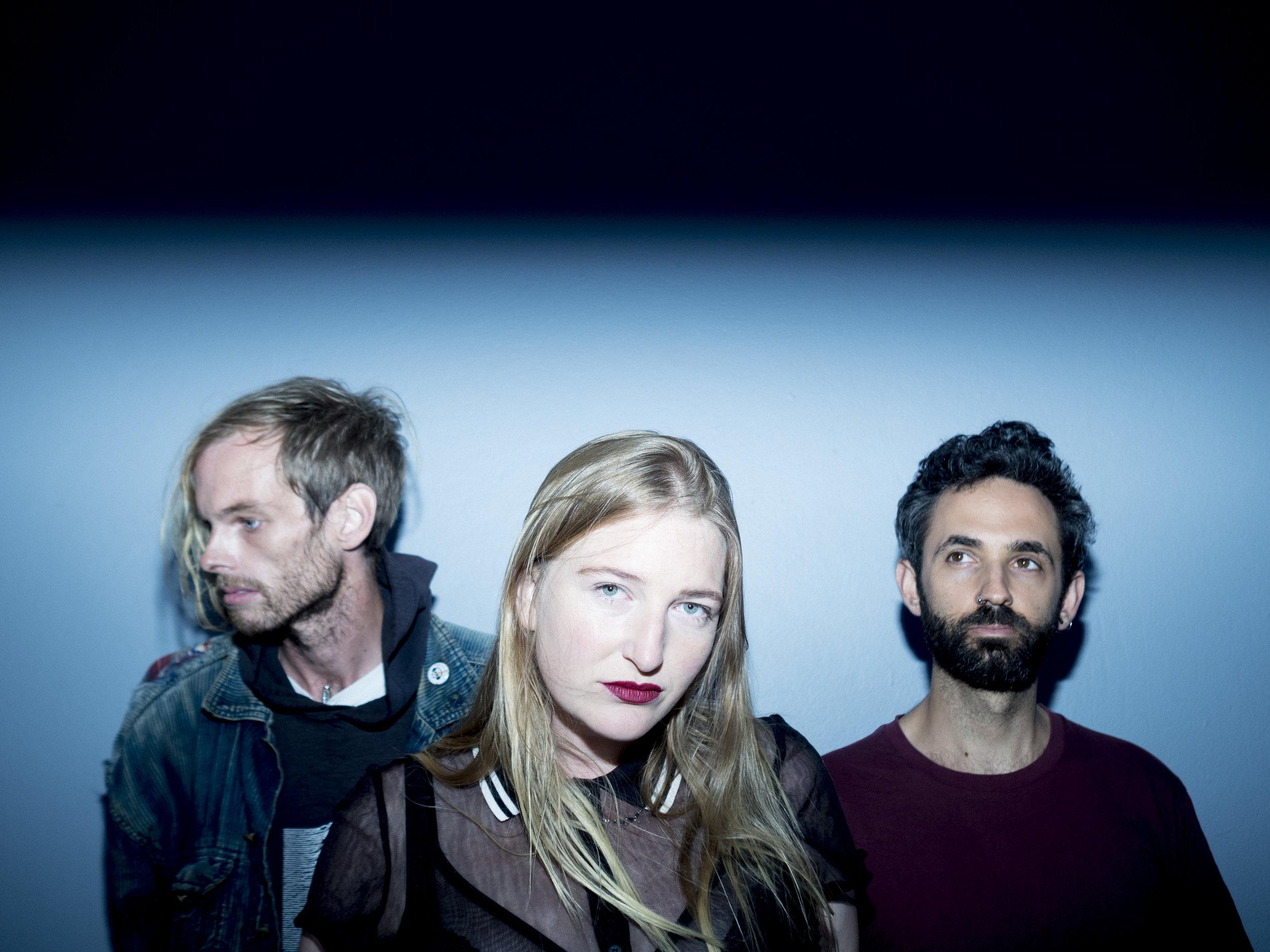 JuliaWhy_band-photographer-Rhea Caldwell-L-R-PeterBeringer(drummer), Julia Wylie (lead singer bassist), Caleb Jacobs (guitarist).jpg