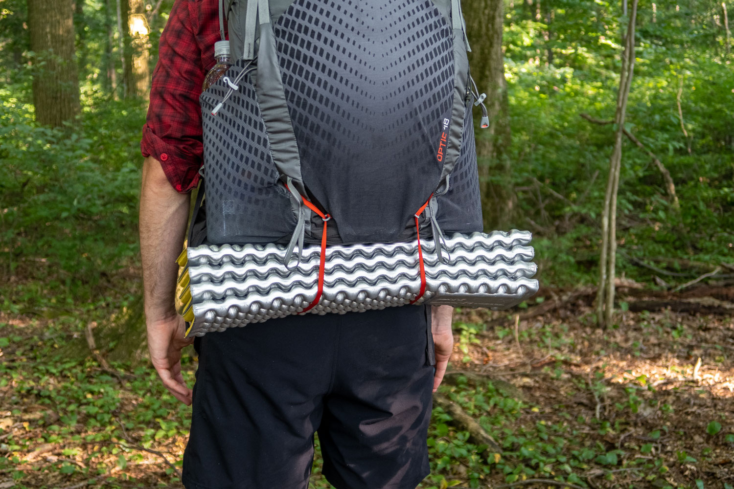 attach a foam pad or tent to the bottom of your pack