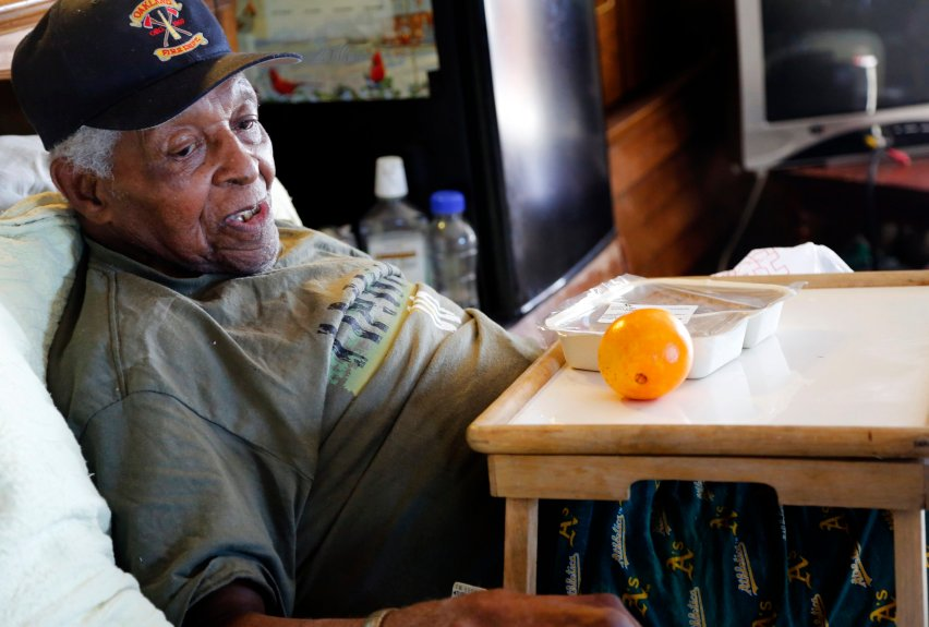 Milton Williams, 95, prepares to eat his meal from Meals on Wheels at his home in Oakland, Calif., on Wednesday, Nov. 16, 2016.  Williams has been a recipient of the Meals on Wheels program for about ten years, allowing him to live at his home of 40 years. (Laura A. Oda/Bay Area News Group)
