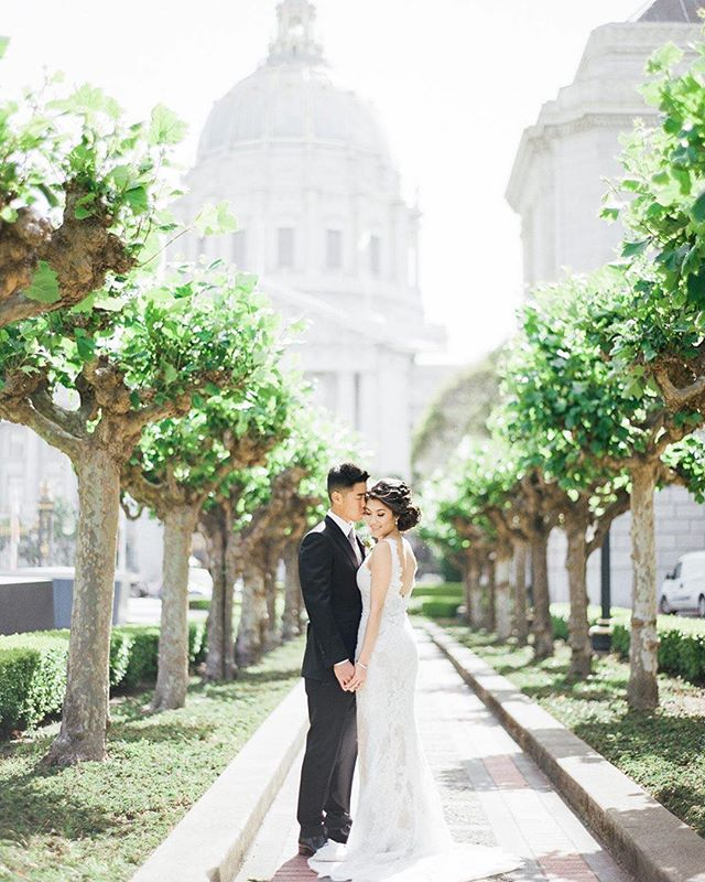 Sharing this beautiful image of K+J during their city hall wedding. 😍 // Photo: @jasmineleephoto  Hair + makeup: @facesbyemily Dress: @pronovias Shoes: @louboutinworld #jasmineleephotography