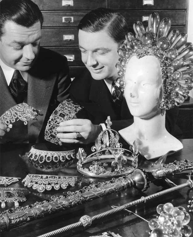 """Above: Joseff and his brother Jimmy Glaser look at their wares. The huge acrylic headpiece was worn by Virginia Bruce in 1936's """"The Great Ziegfeld."""""""