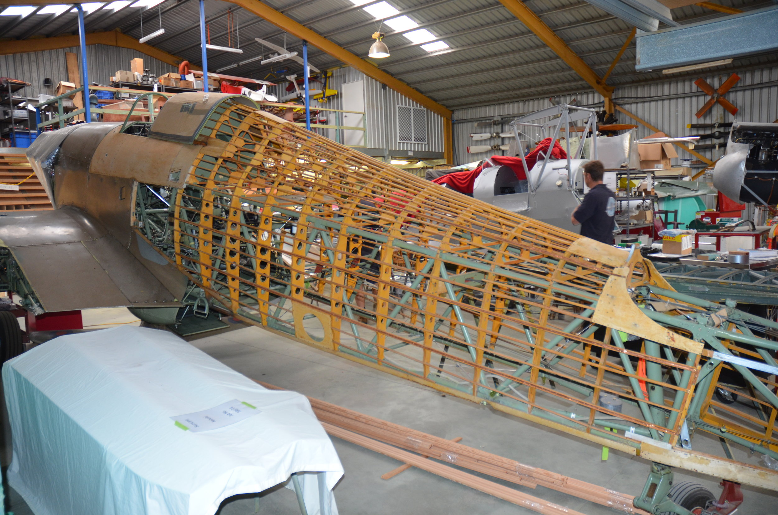 Fuselage undergoing restoration of the wooden structure.