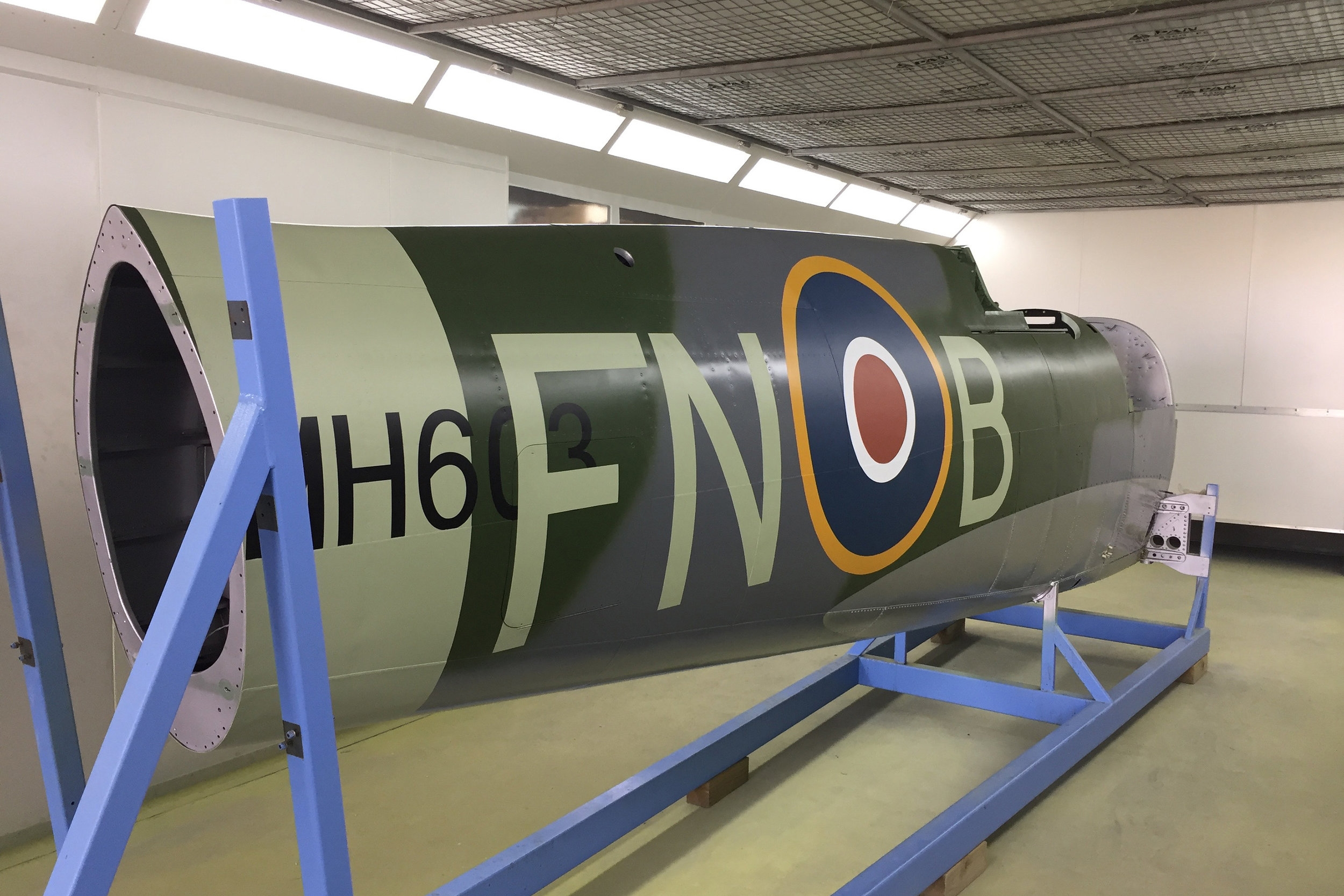 MH603 fuselage in the paint booth after application of markings.