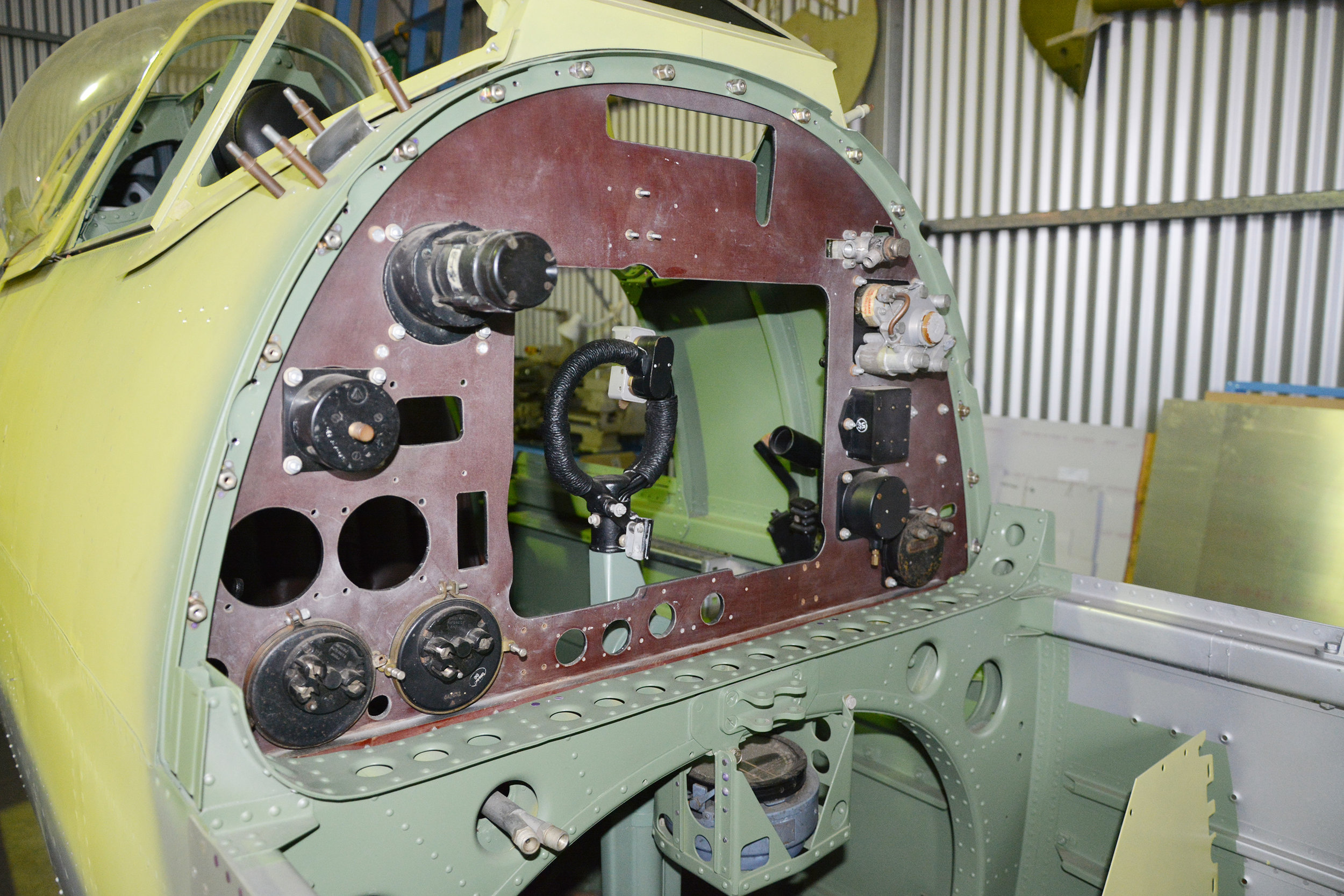 Fuel tank bay showing the back of the instrument panel