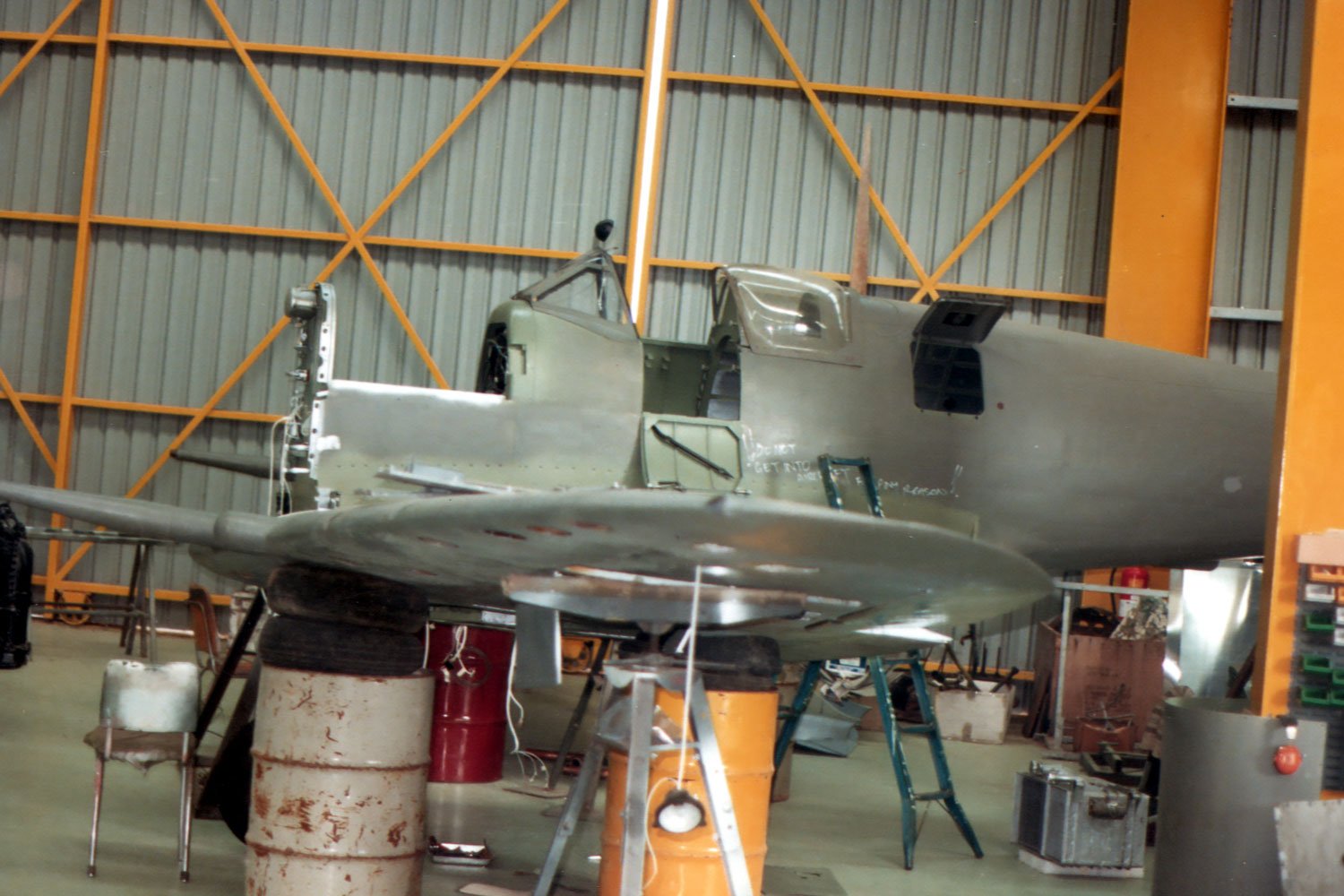 Spitfire VH-HET undergoing restoration by Col Pay 1983