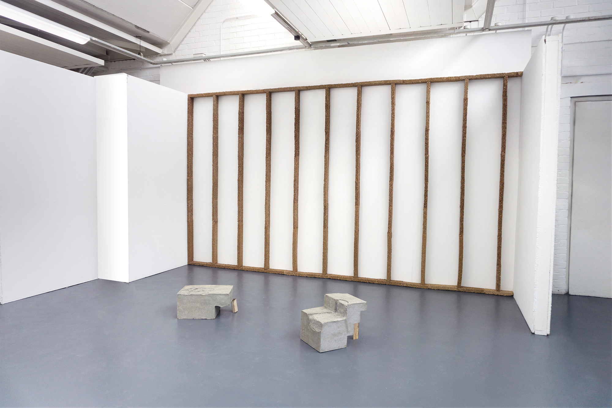 Wall (Dundee) and Broch Bricks , sawdust, paste, concrete, hand-carved lumber, dimensions variable, 2018