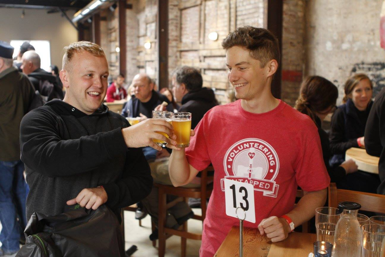 Two of our volunteers enjoying a well-deserved beer at Evil Genius! Photo by  Loaded Pixel