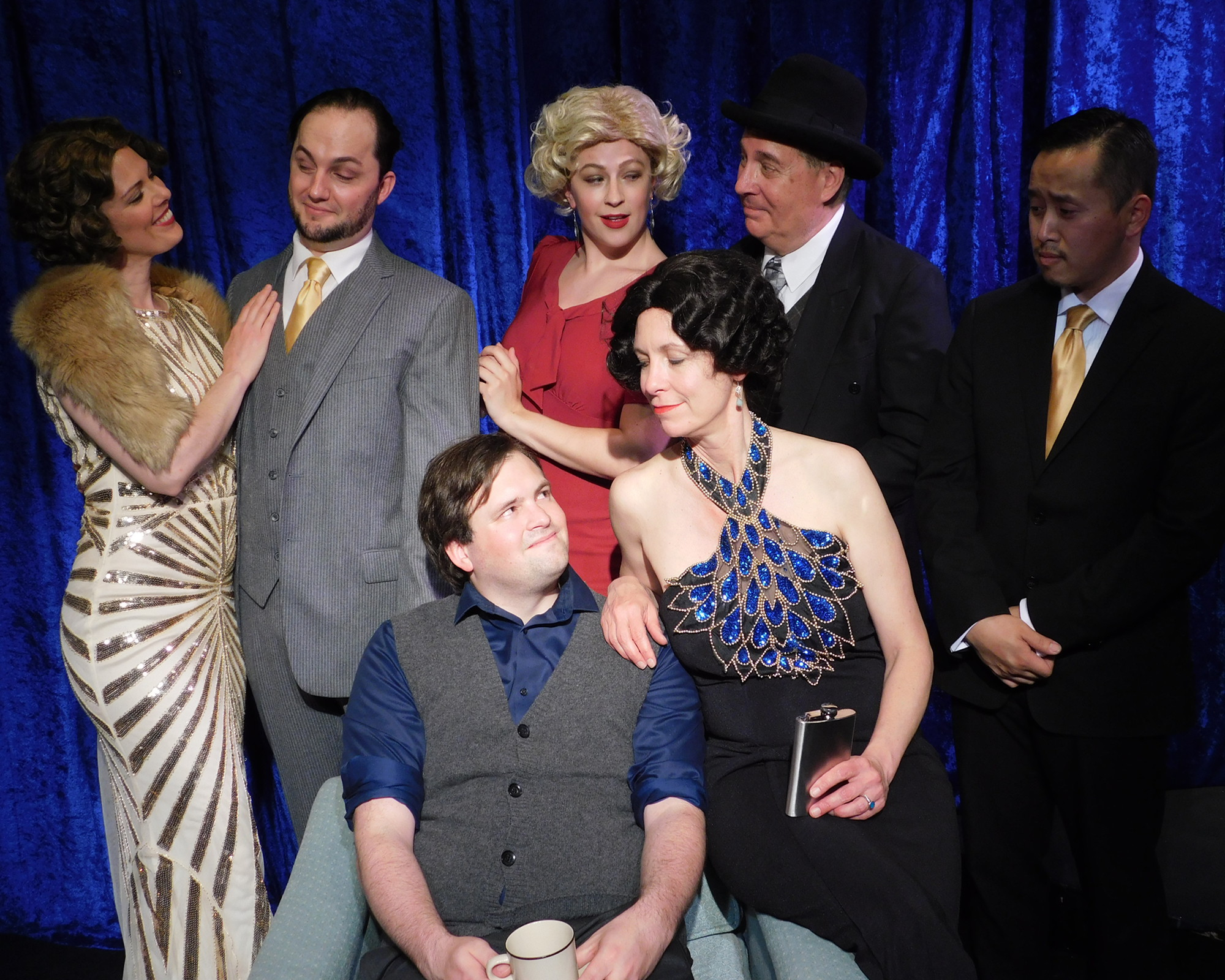 Man in Chair finds himself surrounded by the cast members of his favorite 1920's musical   The Drowsy Chaperone.   Front: Man in Chair (William Rhea) and the Chaperone (Amy Meyers). Rear: Janet Van De Graaff (Minna Rogers), Robert Martin (James Schott), Kitty (Bethany Mindrum), Victor Feldzieg (Charles Evans) and George (Jai Cha).
