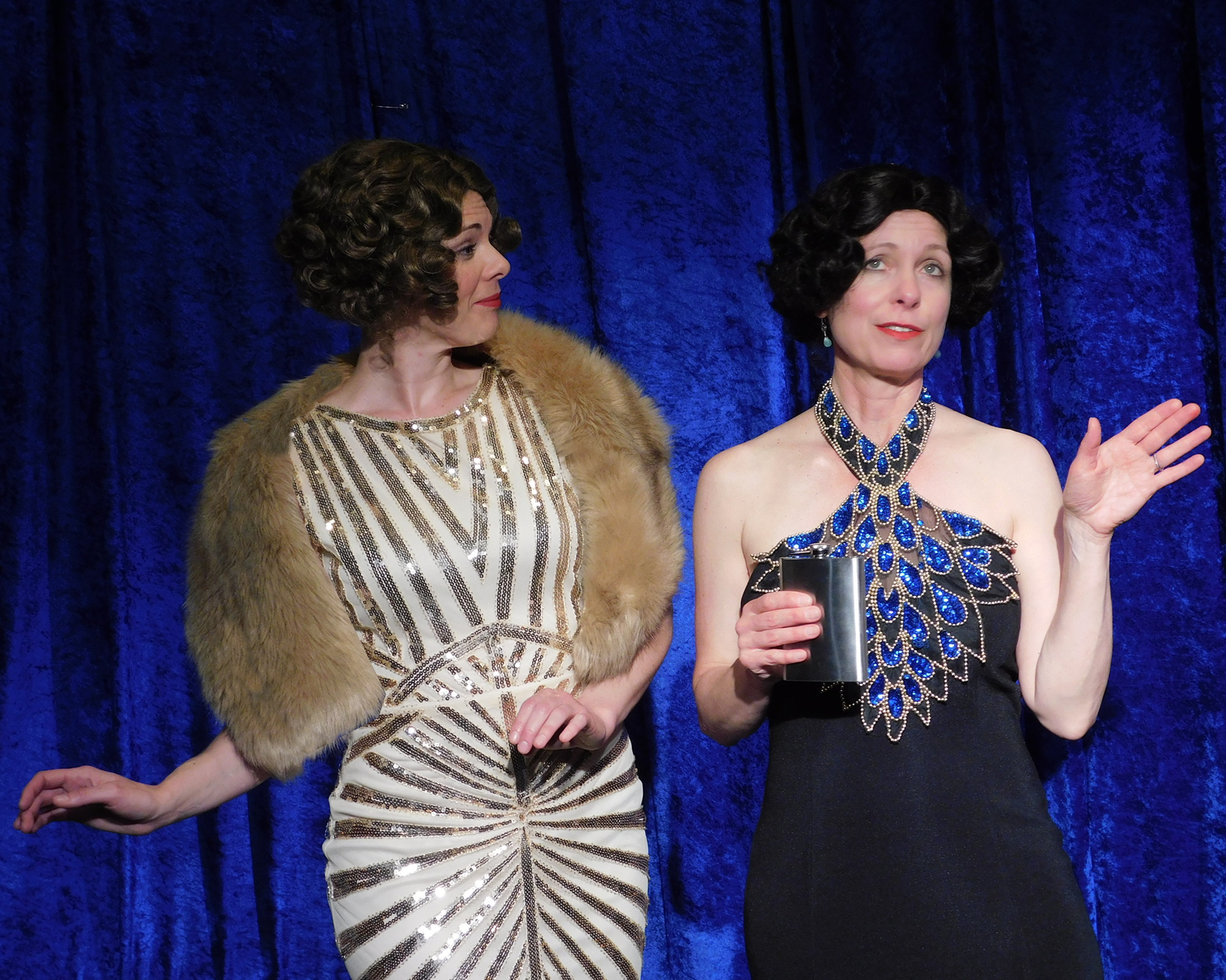 """JANET: """"Have you ever been married, Chaperone?"""" CHAPERONE: """"No, I drink for pleasure, not out of necessity.""""   Janet Van De Graaff (Minna Rogers) and the Chaperone (Amy Meyers) from Landmark Musical Theatre's upcoming production of the Tony Award-winning musical   The Drowsy Chaperone."""