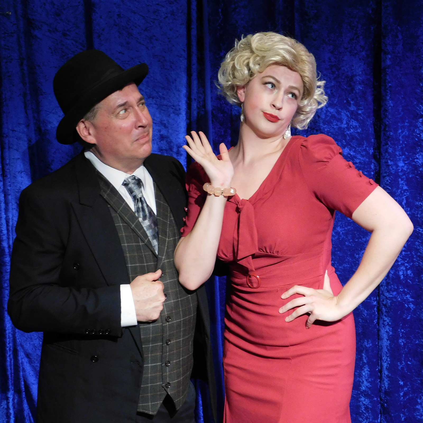 """KITTY: """"Mr. Feldzieg, I can be your leading lady. You said it yourself, I'm useless in the chorus!""""   Victor Feldzieg (Charles Evans) and Kitty (Bethany Mindrum) in Landmark Musical Theatre's upcoming production of the Tony Award-winning musical   The Drowsy Chaperone."""