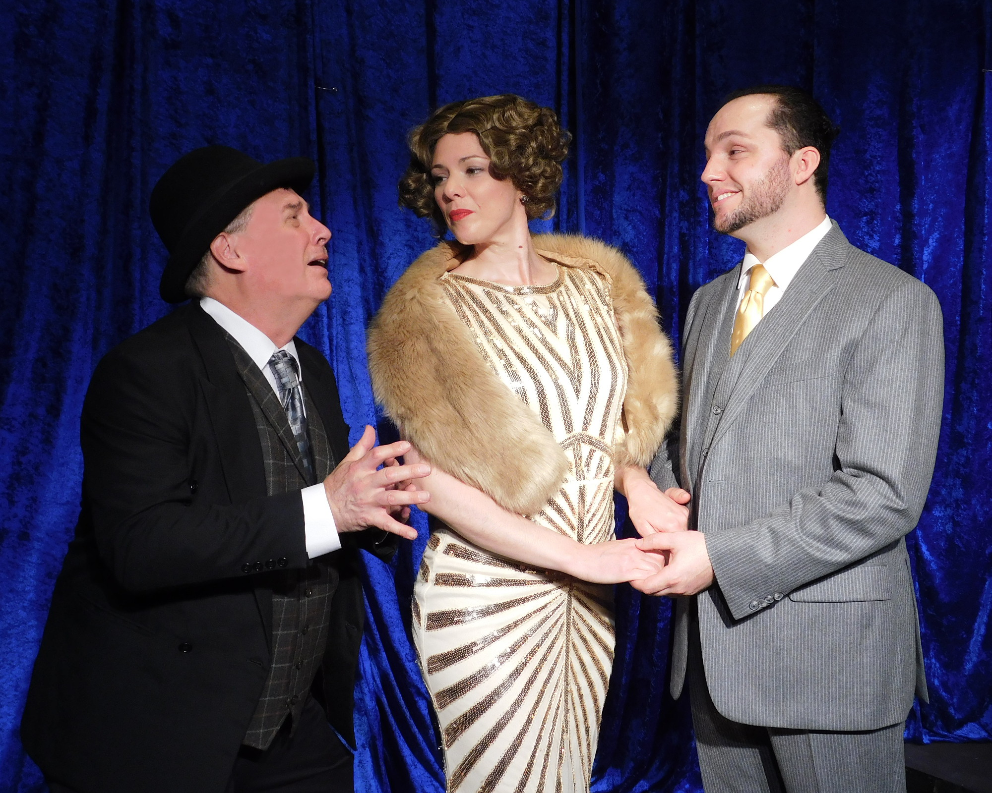 """FELDZIEG: """"Janet, I am begging you! Dump the mug. I'll give you anything you want. I'll put your name above mine on the marquee!""""   Victor Feldzieg (Charles Evans), Janet Van De Graaff (Minna Rogers) and Robert Martin (James Schott) in Landmark Musical Theatre's upcoming production of the Tony Award-winning musical   The Drowsy Chaperone  ."""