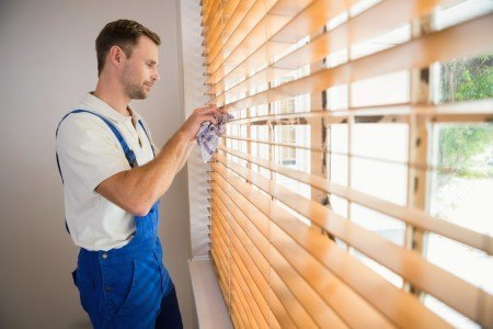 Man-cleaning-blinds-450x300.jpg