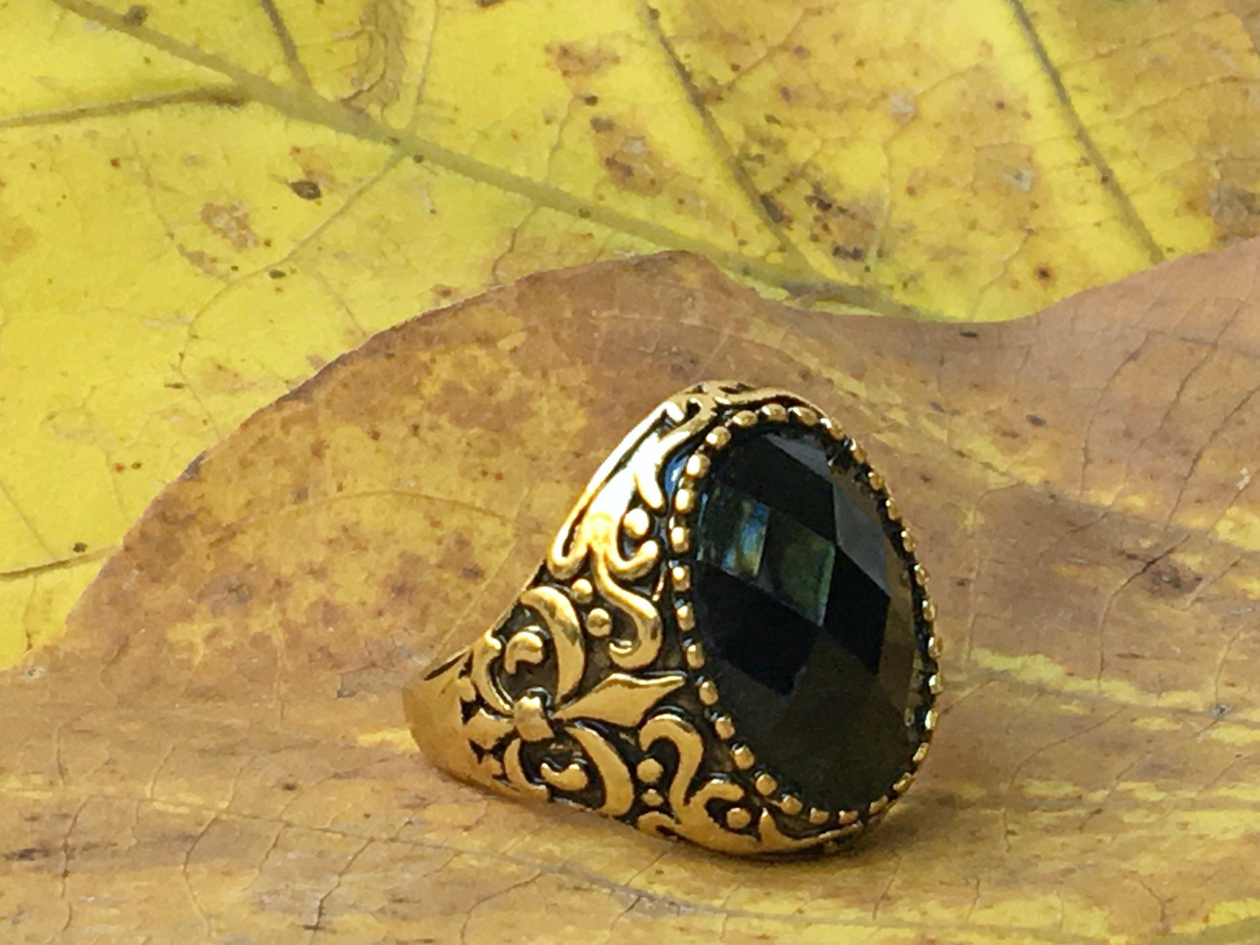 Black spinel oval gold mens ring.jpg