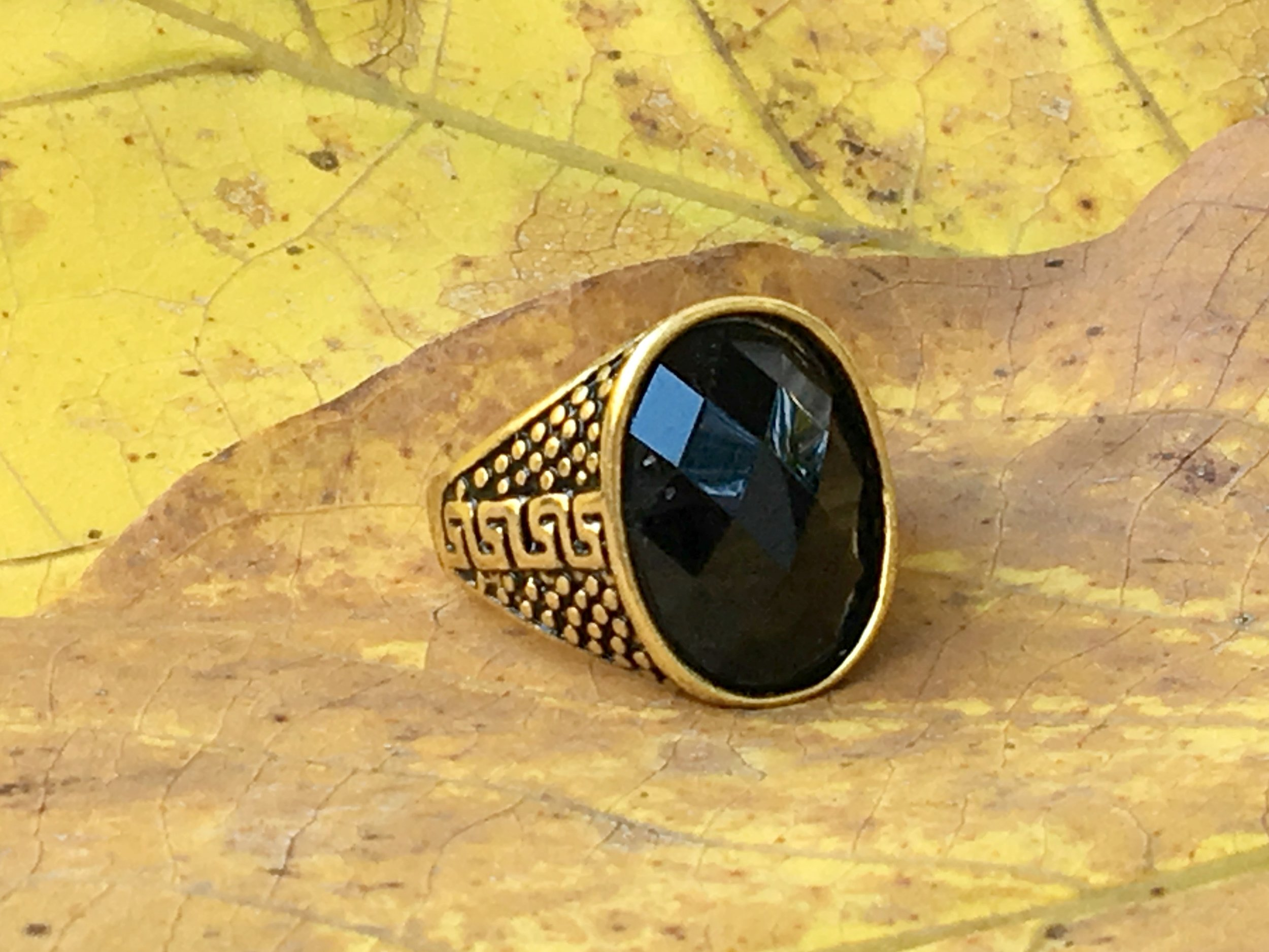 Black spinel oval gold mens.jpg
