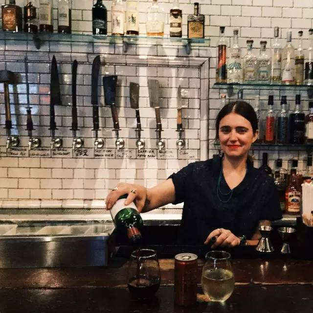 The girl bartender who looks like Frida Kahlo  Beers on tap with knife-shaped handles on the back