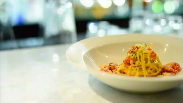 6pc Xiao Long Xia tails, 60g pasta, 35g  peeled and diced tomato flesh, 5g  julienned parsley, 30g dry vermouth, 2g chopped chill, 2g chopped garlic, Salt and lemon juice, Cured egg yolk