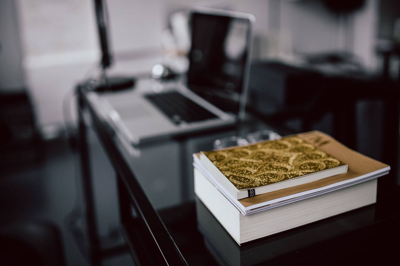 kaboompics_Close-up of golden journals in the office.jpg