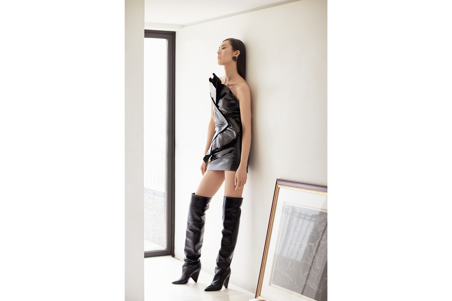 Saint Laurent by Anthony Vaccarello dress, boots and earrings. Image: Russell James