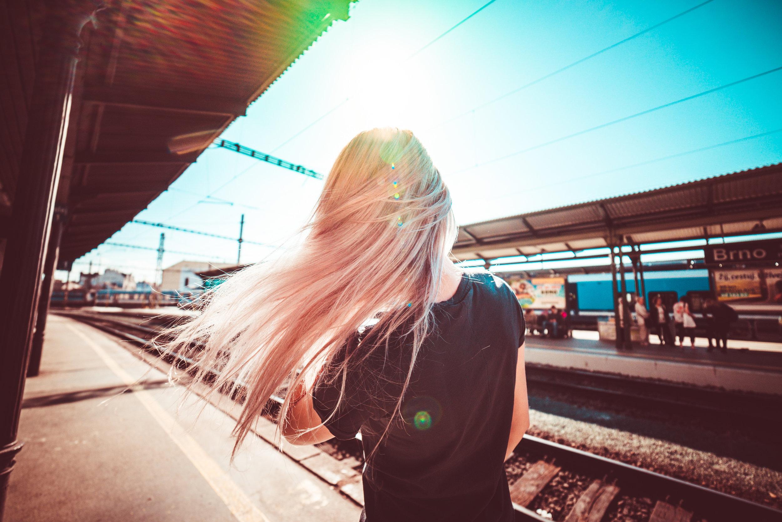 happy-girl-enjoying-free-time-waiting-for-train-picjumbo-com.jpg