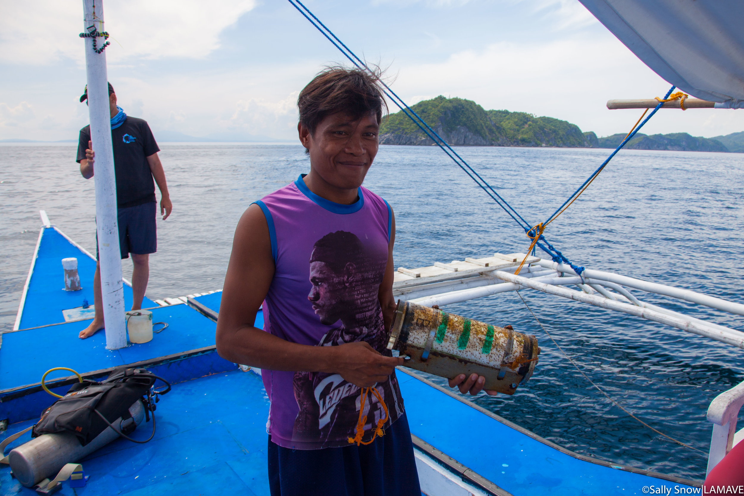 Junar Almincion from Ticao Island Resort helps the team reset and prepare the Remote Underwater Video System.