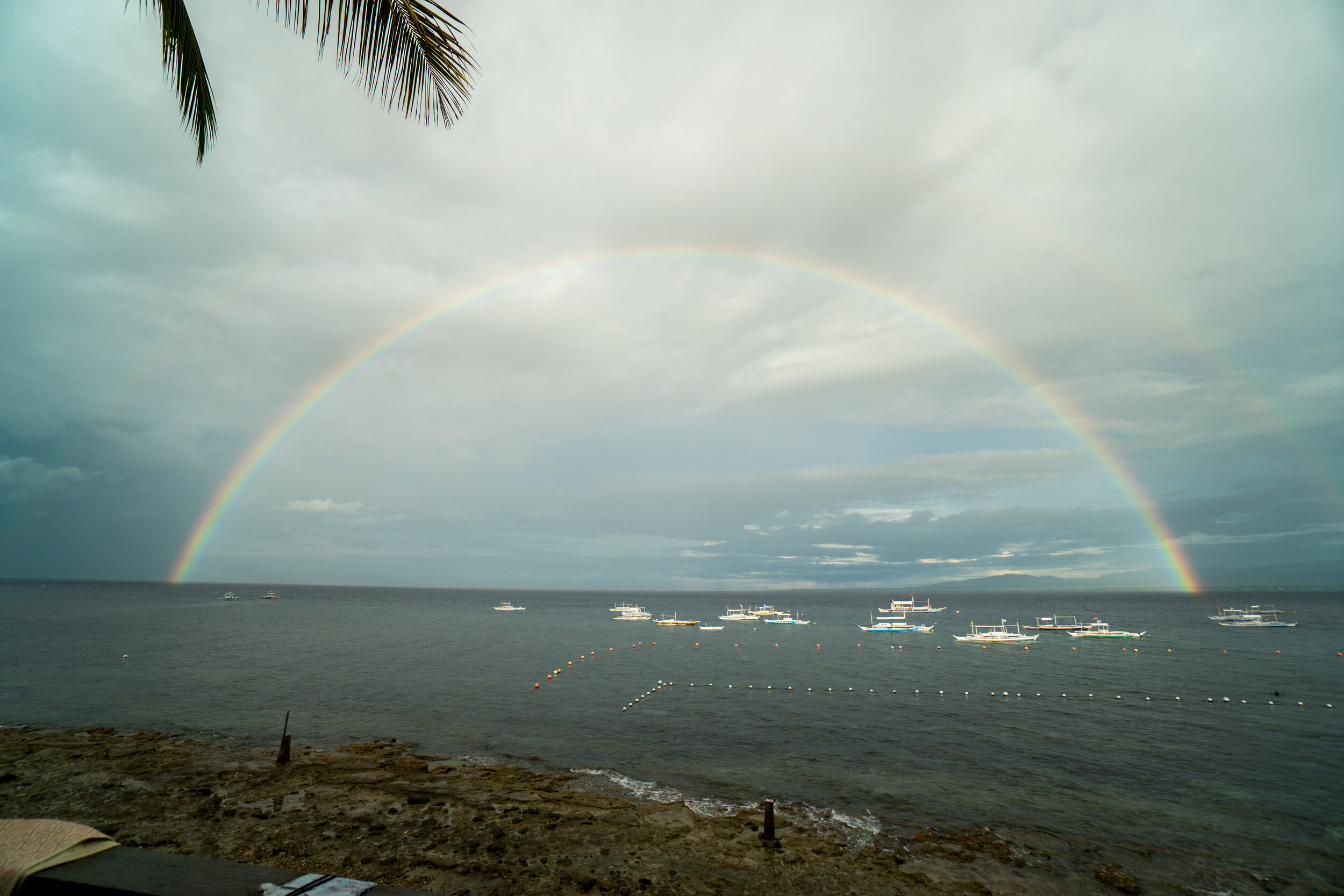 A magical rainbow across the sea facing Apo Island. /Photo by Eric Chocat