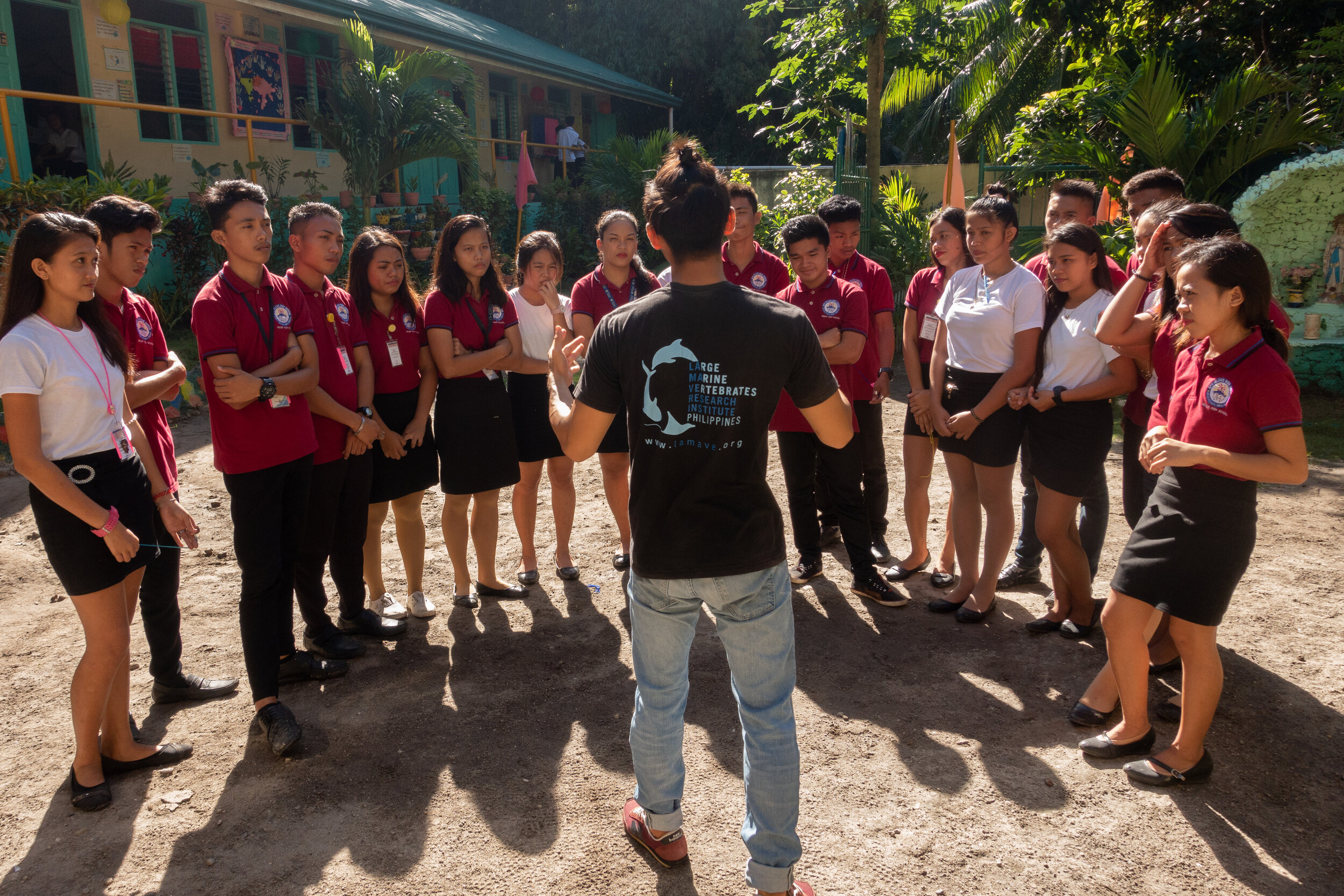 LAMAVE volunteer Calvin Ho interacts with Filipino students during educational activities with Apo Island High School.