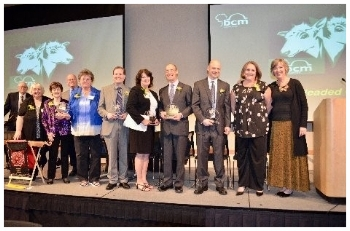 The Winners of the 2-Headed Calf Awards. Pictured far left are Dick, Debbie, Gail, Jeryl, and Patty, HOKD honorees accepting the award for the club.
