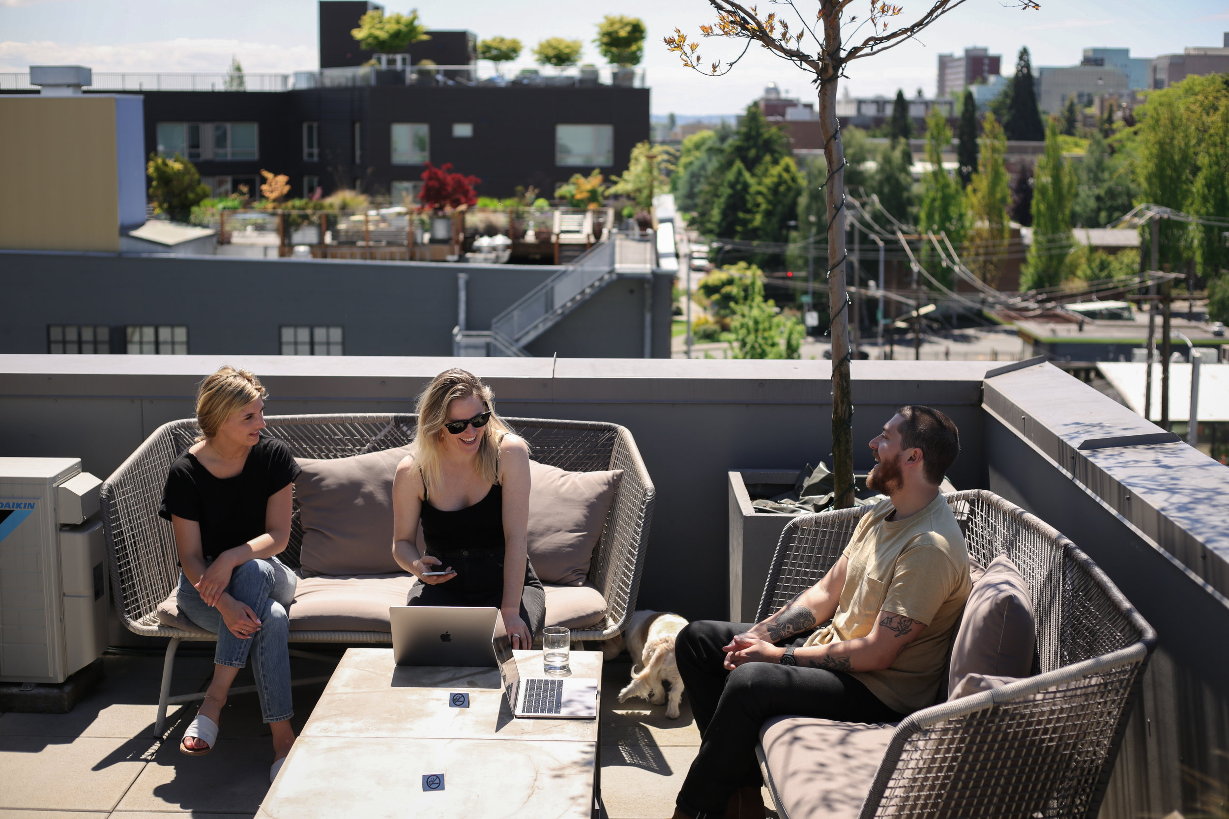 Members of The Cloud Room on the balcony enjoying the sunshine.
