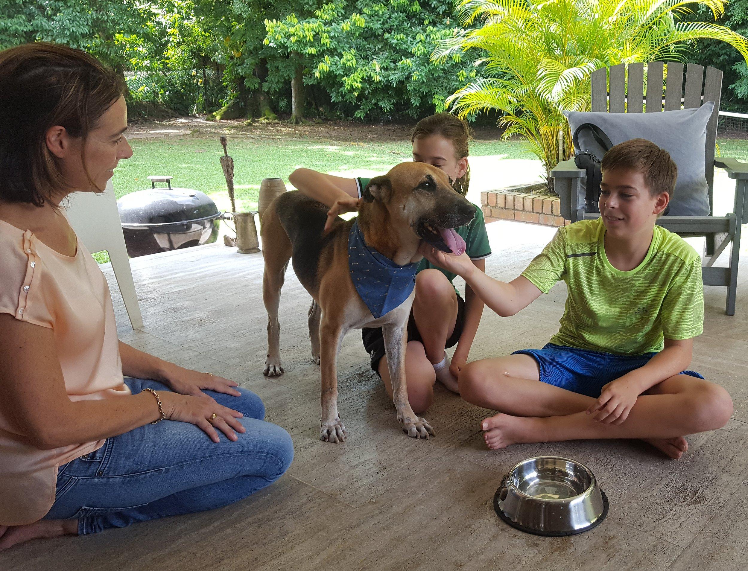 Kiat Kiat with his new family.jpg