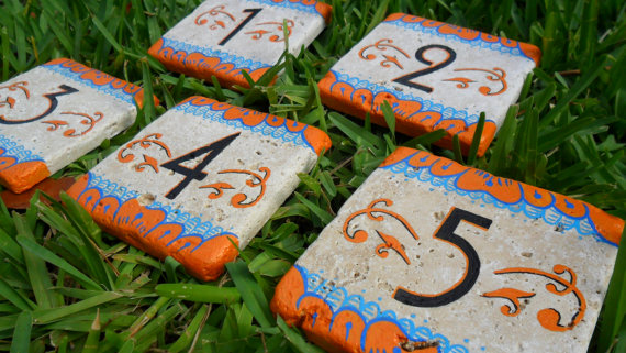 wedding-table-numbers-on-stone.jpg