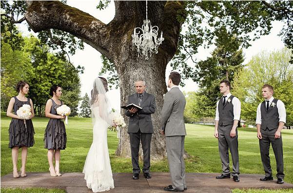 chandelier-hanging-from-tree-wedding.jpg