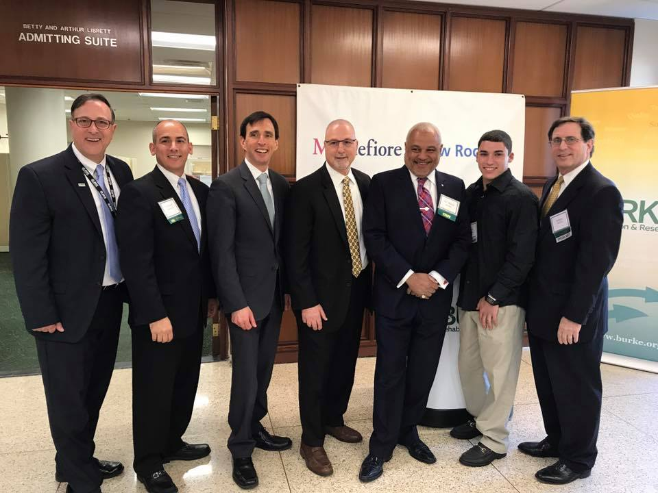 From Left to Right: Richard Sgaglio--Senior Administrator at Burke Rehabilitation Anthony B. Gioffre, III--Burke Board of Trustees Member Noam Bramson--Mayor of New Rochelle Anthony Alfano--Vice President and Executive Director at Montefiore New Rochelle Barry Jordan MD--Assistant Medical Director at Burke Rehabilitation Max--Faces of Burke Participant Jeffrey Menkes--President and CEO at Burke Rehabilitation