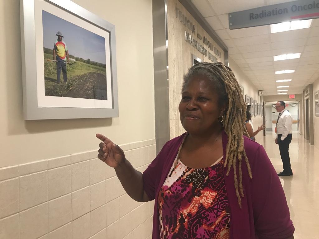 Karen Washington walking through exhibition on Community Enrichment Day.