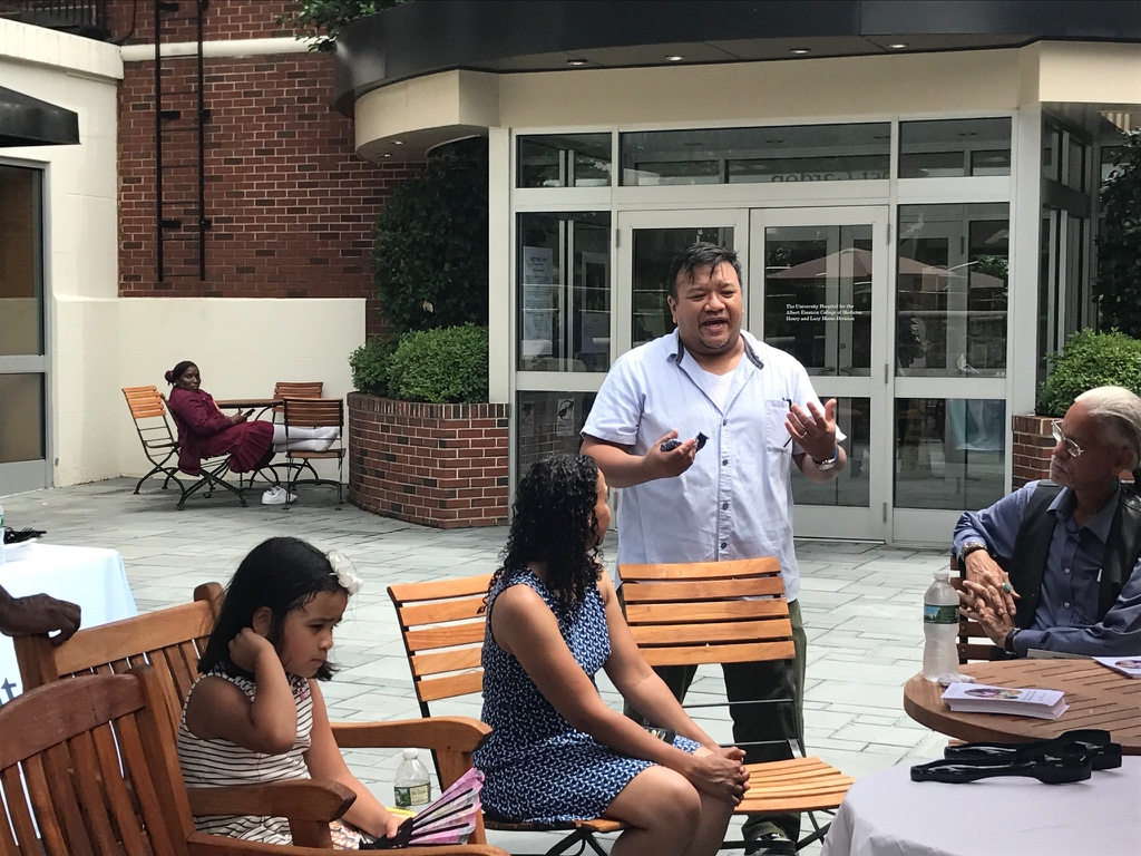 Creator of the Bronx Salad, Chef King Phojanakong, speaking at the Community Enrichment Day.