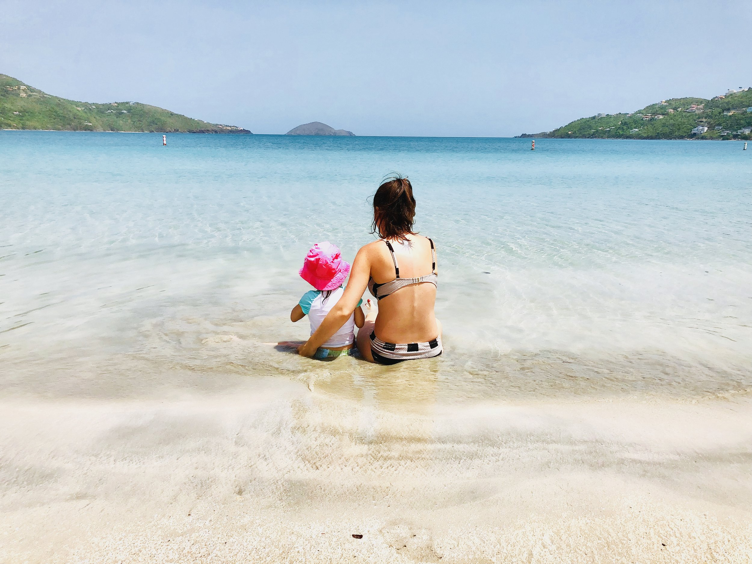 Ella and her mom relaxing in the warm Caribbean Sea.
