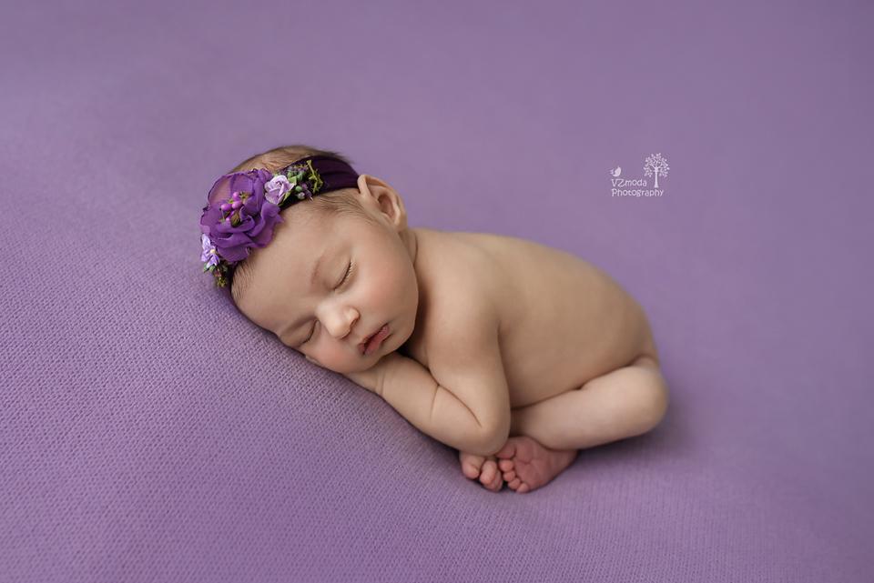 newborn taco pose
